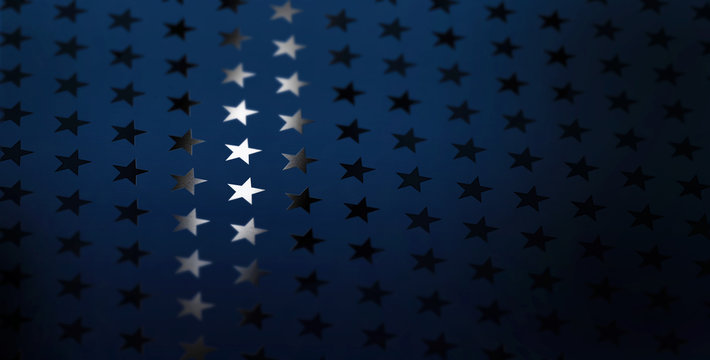 A star pattern of spot uv varnish print on blue note paper background.