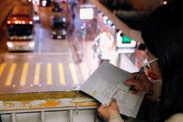 A woman writes Christmas cards for people who are in detention during the recent protests in Hong Kong