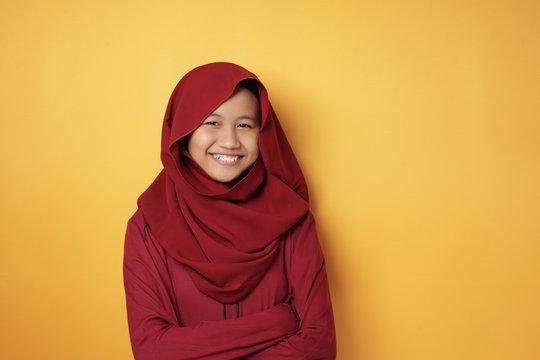 Asian Muslim Teenage Girl Wearing Hijab Smiling at Camera