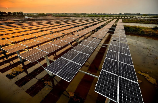 Aerial outdoor solar photovoltaic base in Asia under sunset