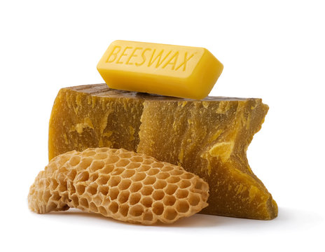 How to get natural organic beeswax. Pieces of organic beeswax on a white background. The use of beeswax in apitherapy. Production Ingredient for Medical and Cosmetics.
