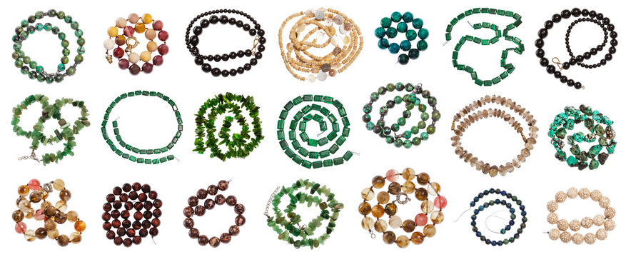 set of various coiled strings of beads isolated