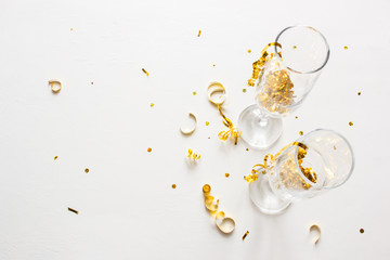 two champagne glasses with confetti on a white background with place for text
