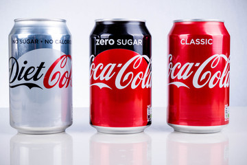 London, United Kingdom - May 11, 2017. Can of Coke Zero, Diet Coke & Classic Coca-Cola. Classic Coca-Cola has aproximately seven teaspoons of sugar per 330ml can, unlike Diet Coke and Coke Zero