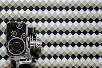 8mm camera on geometric background