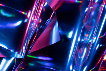 Reflection of light on holographic foils with neon lighting