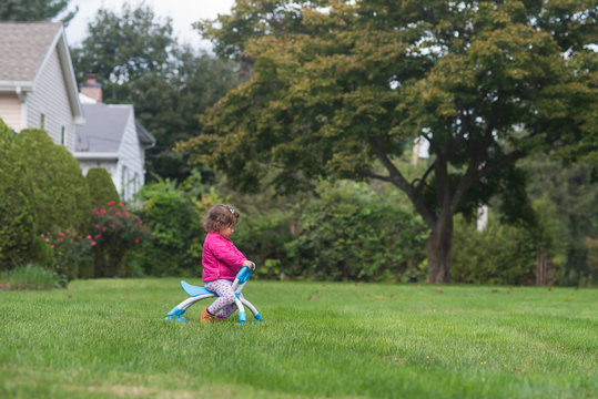 Little girl playing on the grass
