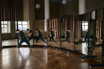 Dancer reflecting in set of mirrors