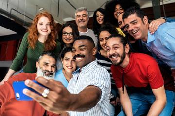 Business people taking selfie
