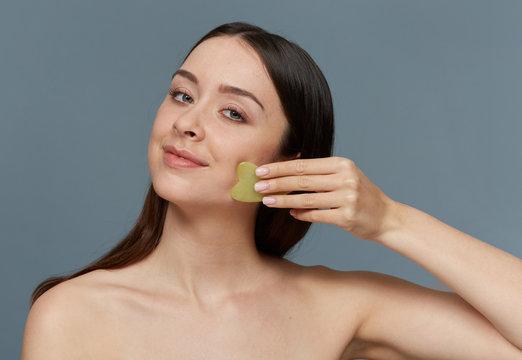 Gua Sha stone facial massage