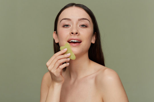 Facial lymphatic drainage with Gua Sha stone