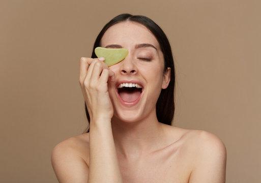 Gua Sha stone helps your skin