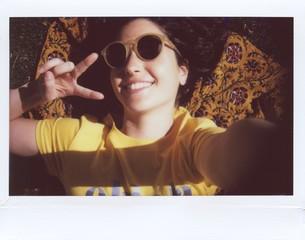 Cool girl taking selfie in sunlight