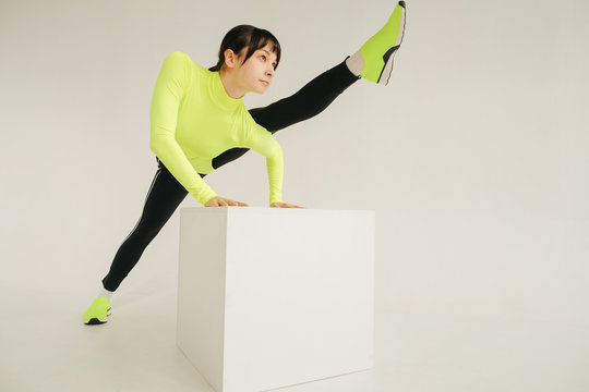 Athlete exercising on cube