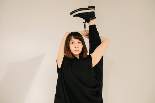 Young dancer performing vertical split