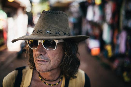Mature man in cowboy hat on street