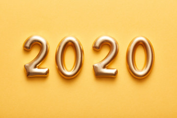 Golden numbers 2020 on yellow background