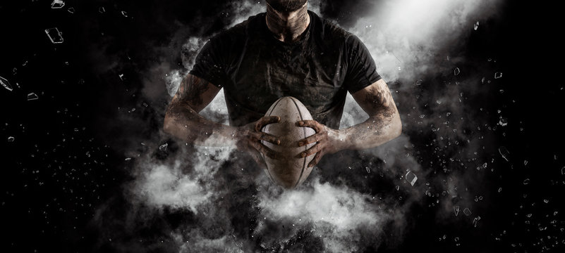 Rugby player in action on dark