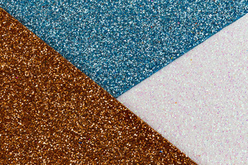 Blue, white and Gold glitter texture abstract background. Shape of the triangle