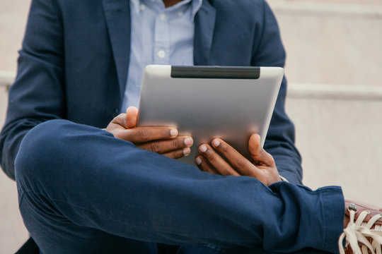 Close up of a Businessman using tablet computer