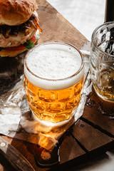 Beer on a wooden board backlit