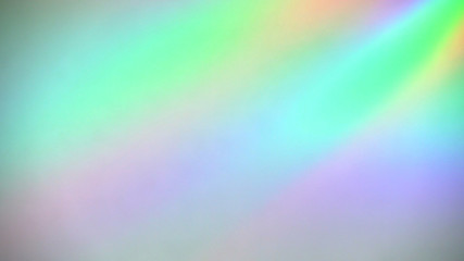 Sparkling holographic light spectrum reflections on paper