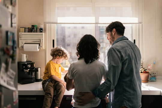Family in kitchen at home