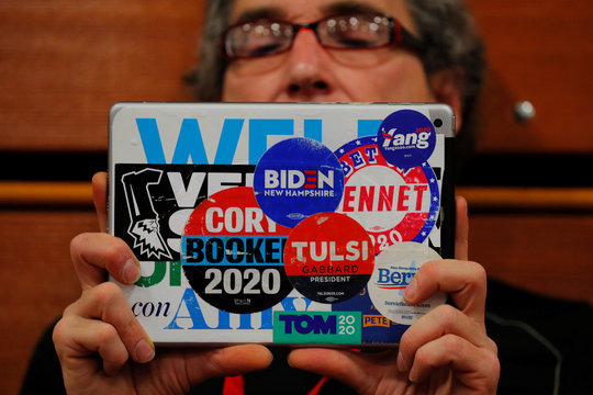 An audience member uses an iPad covered in campaign stickers to record a campaign event with Democratic 2020 U.S. presidential candidate Sanders in Manchester