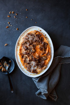 Sweet potato and pumpkin casserole with pecan nuts and coconut topping