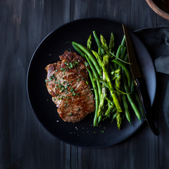 Grilled beef steak with vegetables green beans and asparagus