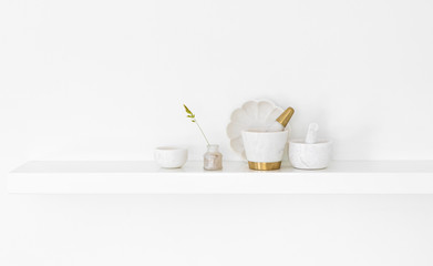 Kitchen wall shelf with white marble crockery