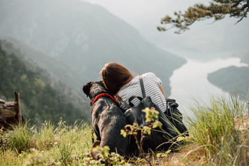 Woman and dog in nature
