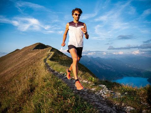 trail runner on mountain ridge