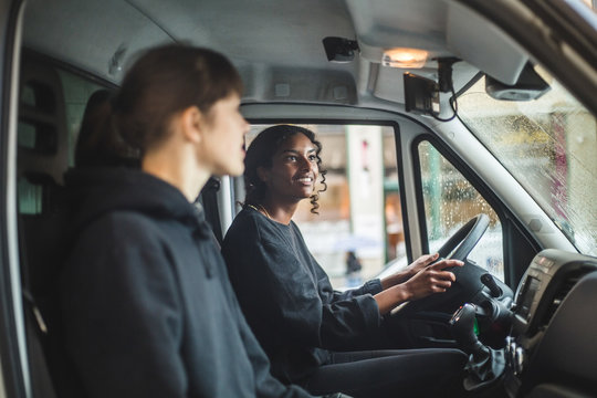 Mover looking in rear view mirror while driving delivery van