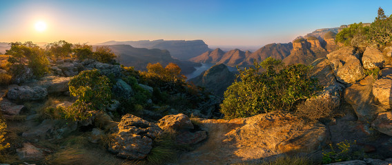 Fotobehang Afrika three rondavels and blyde river canyon at sunset, south africa