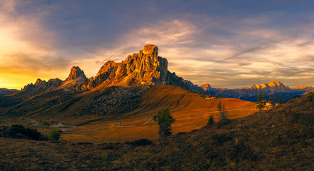 Foto auf Gartenposter Beige Landscape view of the Italian Dolomites on Passo Giau. Sunset with beautiful blue sky and setting sun.