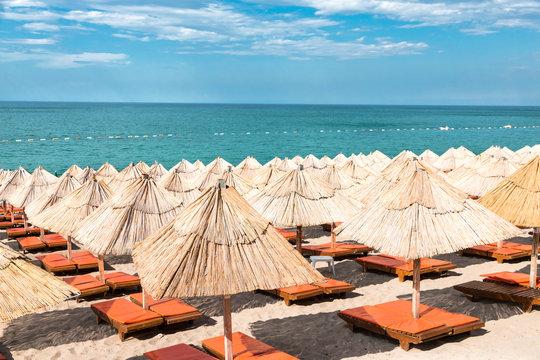 Sunny beach and blue sea on Mediterranean coast.