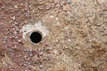 Kernlochbohrung in einem Betonrohr