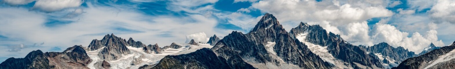 Panorama the Aiguille du Chardonnay and surrounds above Argentiere and Chamonix with cloudy blue sky