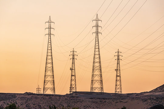 Power lines from the Aswan dam hydroelectric power plant at sunset