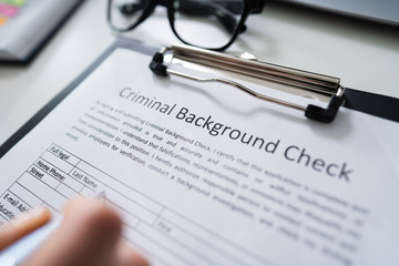 Hand Filling Criminal Background Check Application Form - fototapety na wymiar