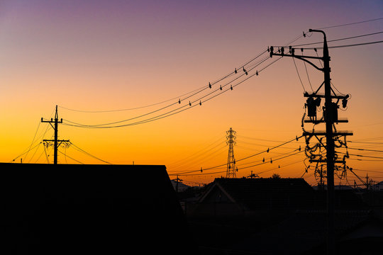 写真素材: 安城市 朝焼け 電線 電柱