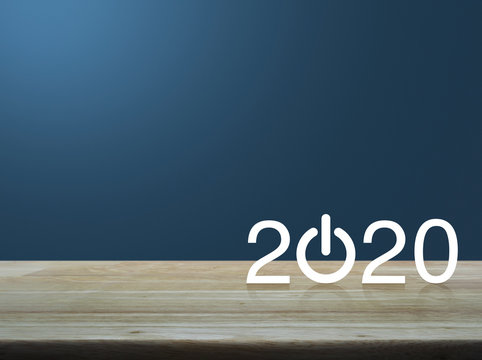 2020 start up business flat icon on wooden table over light blue gradient background, Happy new year 2020 concept