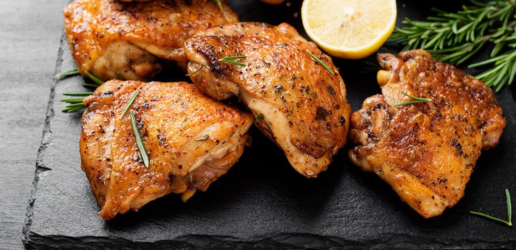 Grilled chicken thighs with spices and lemon.