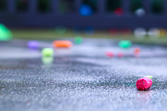 Sidewalk Chalk on rainy sidwalk