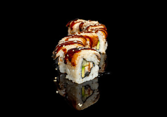 In de dag Sushi bar sushi and rolls with different fillings on a black background with reflection