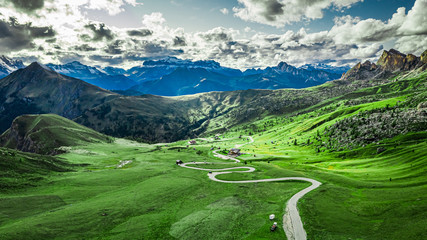Foto op Canvas Bleke violet Winding road in Passo Giau and green Dolomites, aerial view