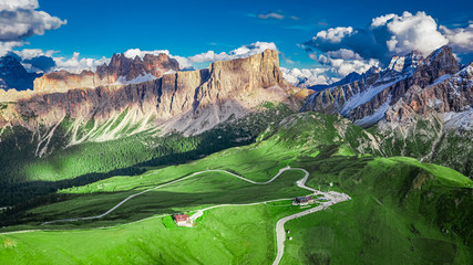 Wall Mural - Aerial view of green hills and Passo Giau in Dolomites