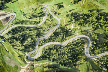 Wall Mural - Top down view of winding road at Passo Gardena, Dolomites
