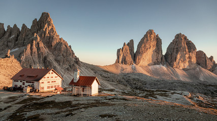 Wall Mural - Panorama of Dreizinnen Hut and Tre Cime at sunset, Dolomites